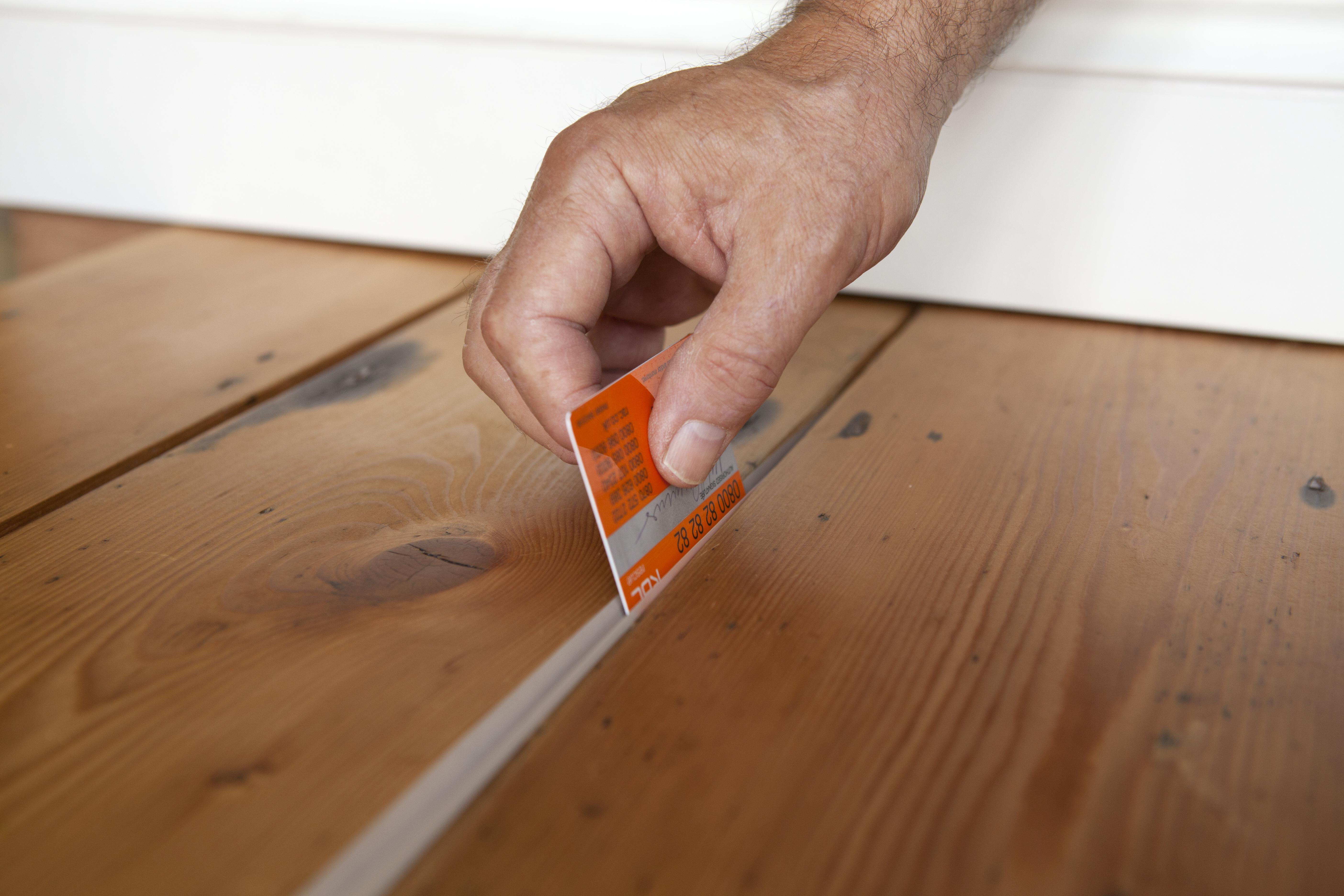 Filling Gaps In Floorboards With Stopgap