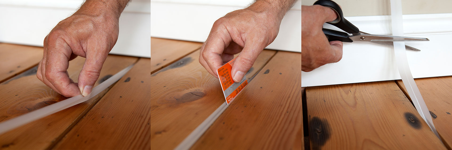 Fitting StopGap. Starting at one end if gap, fold strip along crease, and using a plastic card, push into gap with V downwards until contact with joist below. Cut to length at far end of gap
