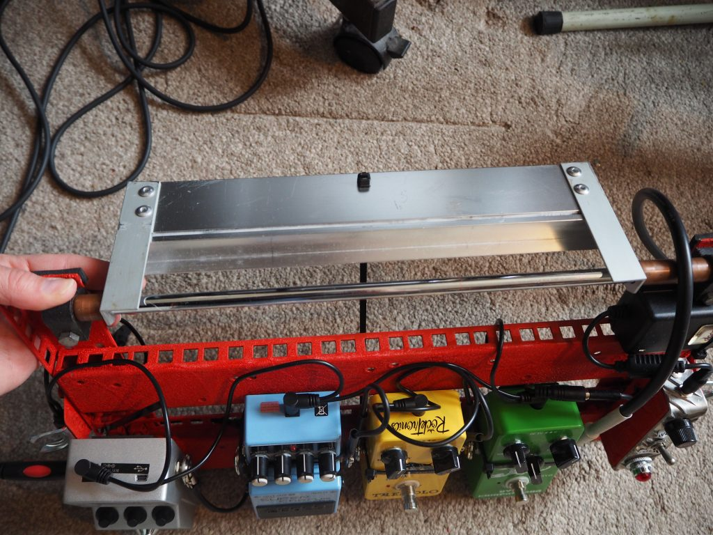 Stand at rear of guitar pedal board