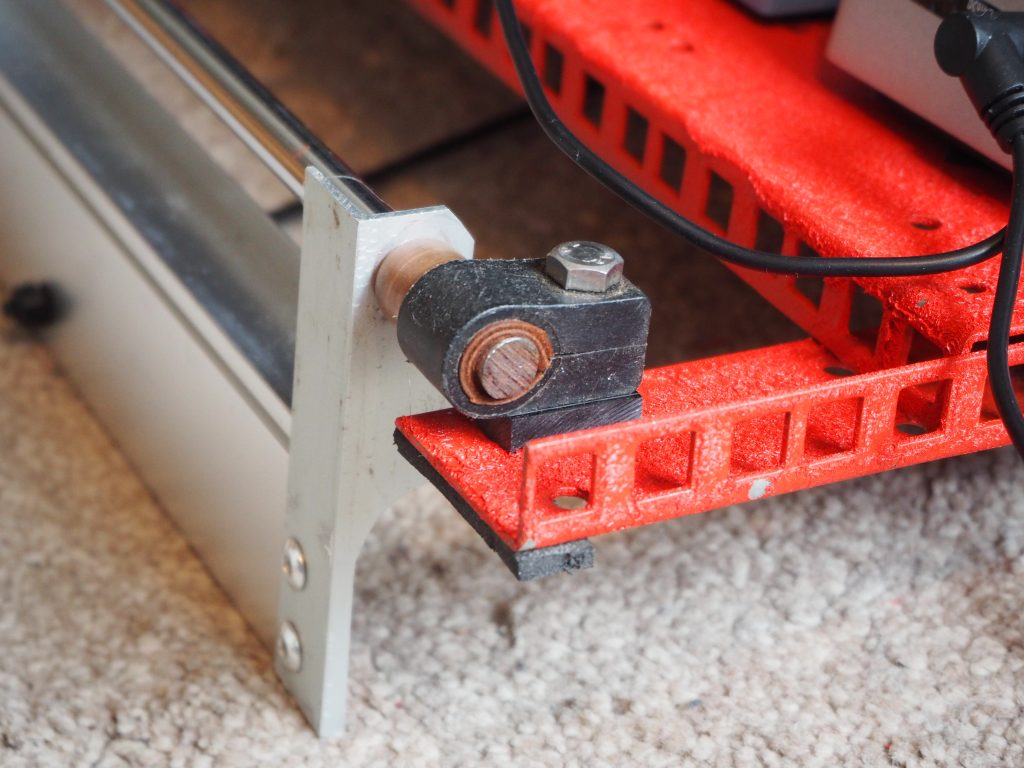 Hinge of stand on back of guitar pedal board